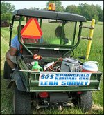 2 people on a heavy duty golf cart performing the natural gas leak survey