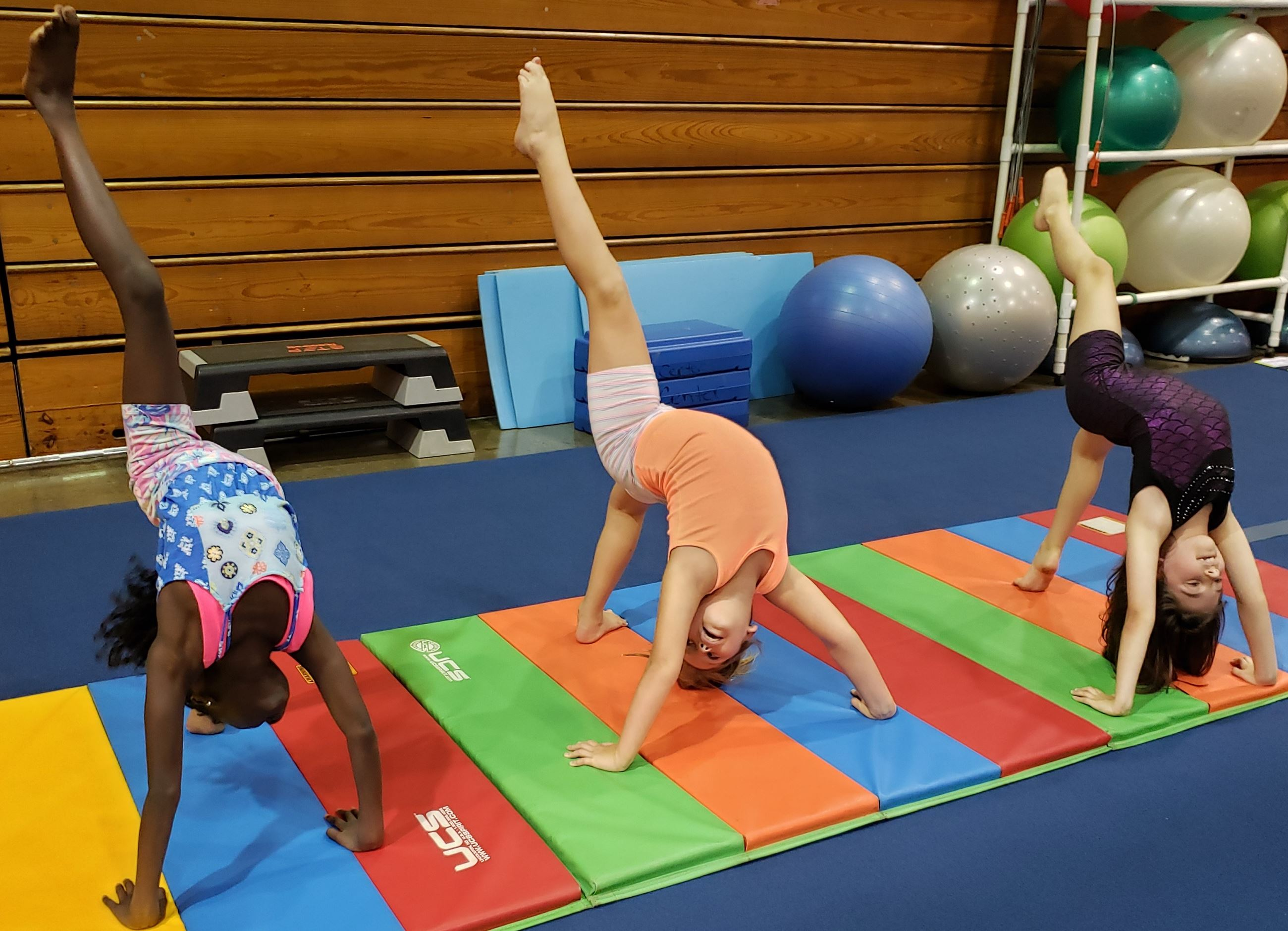 gymnastics at The Center Springfield TN students show backbend with one leg extended