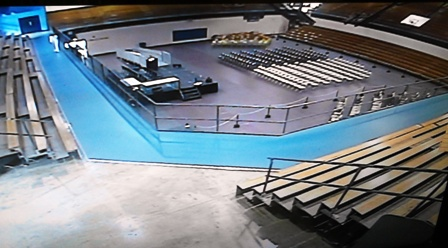 The Center, gym-auditorium event set-up example, balcony track level view to main level.  All four side bleachers for spectators.