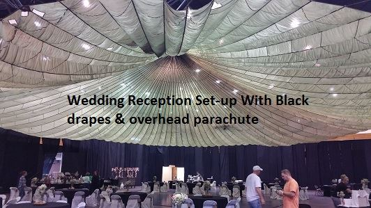 Recption at The Center featuring black drapes covering walls & parachute overhead