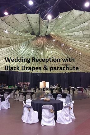 Reception decorations featuring black drapes background & parachute overhead
